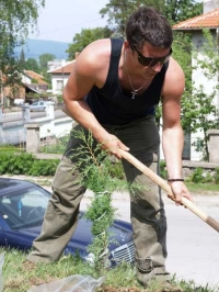Serbian photographer Nikola Vukojevic in action of planting trees